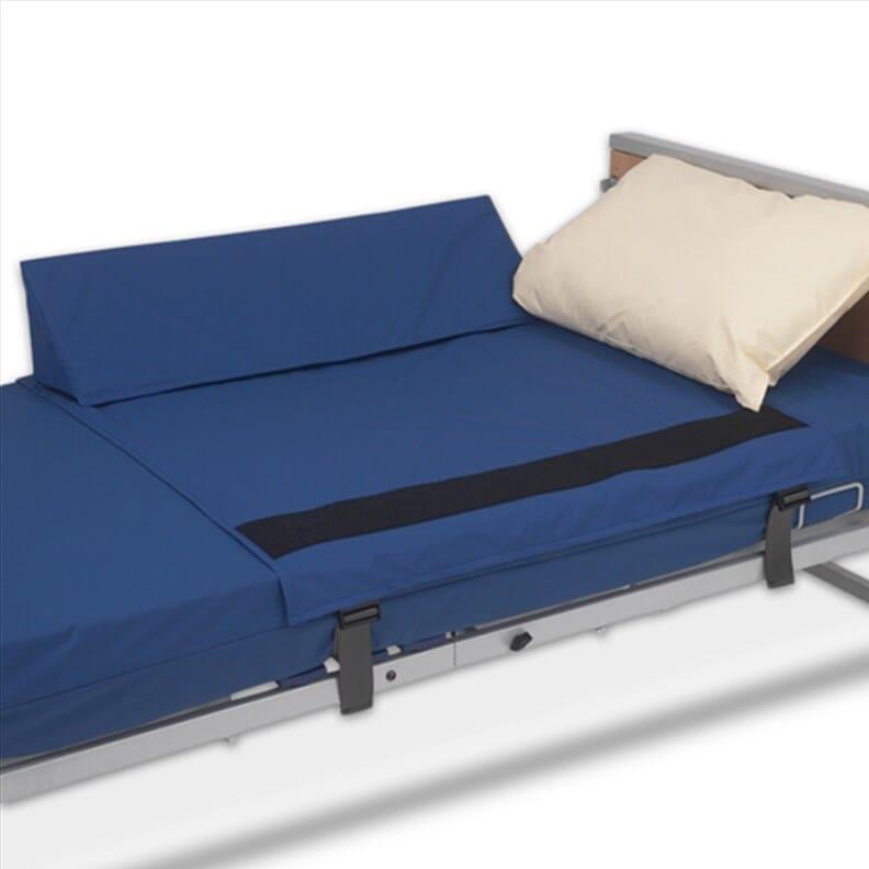 Cales latérales de maintien au lit